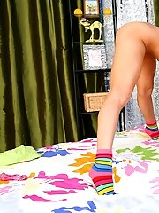 Girlie undresses on cam