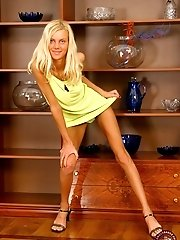 Beautiful blonde angel shows off her tight body