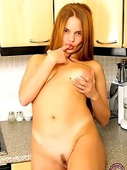 Young Model Gets Horny Right In The Kitchen