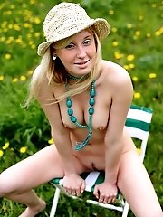 Cute Girl With Nice Body Poses For You Having Only A Straw Hat On Her Blonde Head