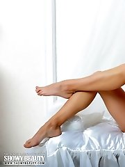 Gorgeous Bombshell With Stunning Eyes Posing Absolutely Naked With Saxophone On The Bed.