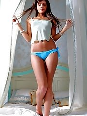 Gorgeous Teen Beauty With Excellent Straight Long Hair Showing Shaved Pussy On The Bed.