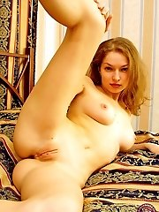 Incredibly beautiful babe plays alone in bed