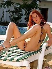 Extremely hot red-head strips by the pool