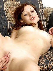 Provocatively sexy young redhead harlot