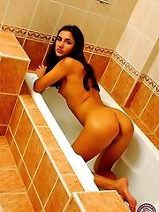 Gorgeous brunette plays all alone in the bathroom