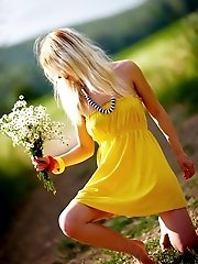 Stunning Blonde Cutie Starts With Posing In Yellow Dress Then Gets Rid Of It Very Willingly.