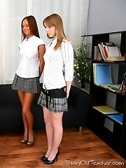 Perverted young girls play with thir teacher's cock.