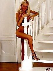 Horny young blonde plays solo on the stairs