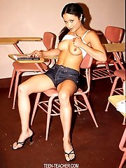 Nice small brunette with huge nipples and an amazing ass gets naked in a classroom.