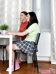 Two nubile schoolgirl teens are made to eat each other out for MILF teacher.